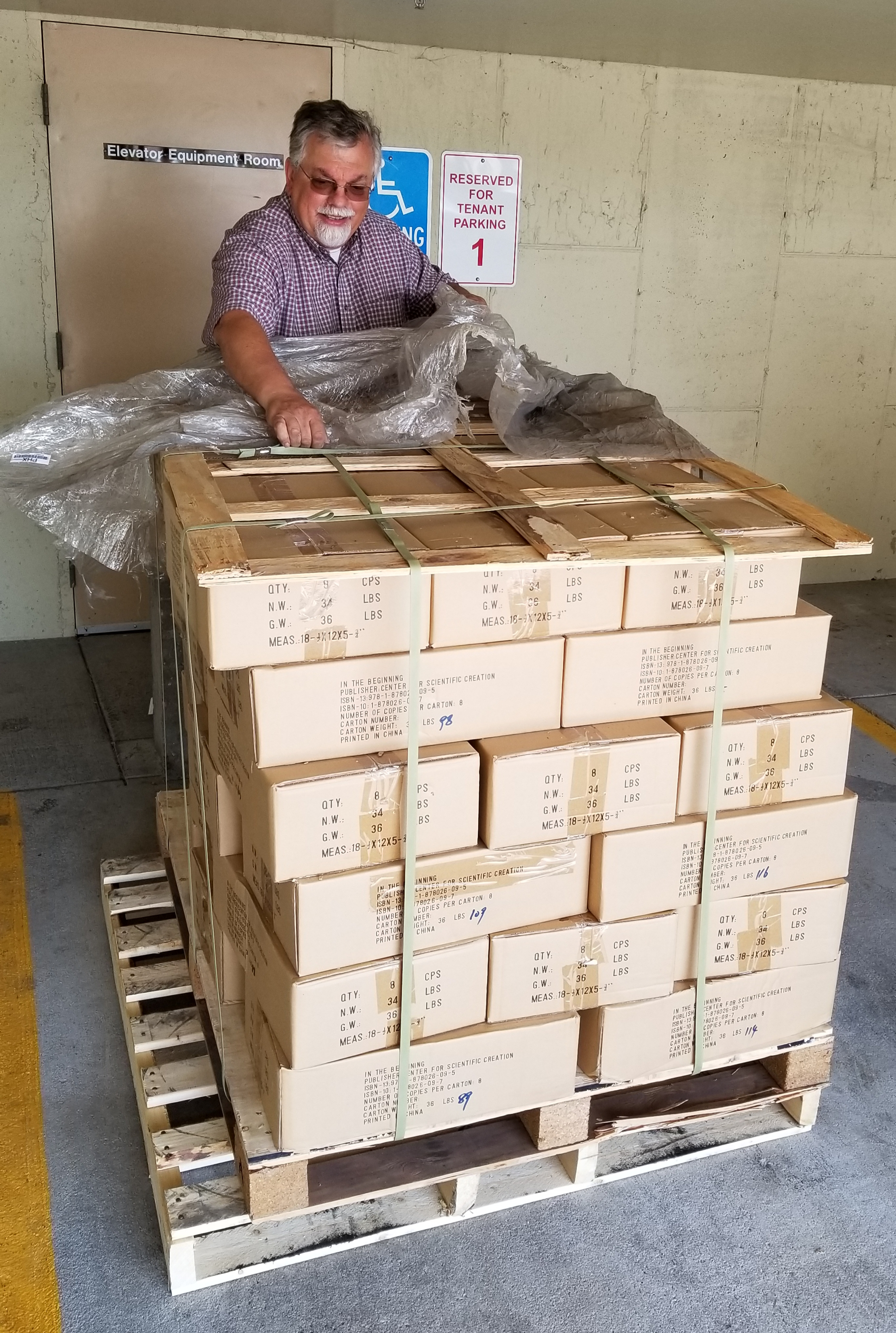 A whole pallet of Walt Brown's In the Beginning books delivered to the RSR studios!