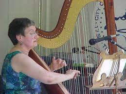 Photo of Ann Habermehl playing the harp