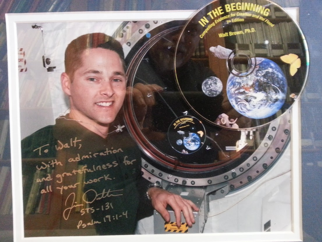 Astronaut in space station with Walt's book (on disc) In the Beginning