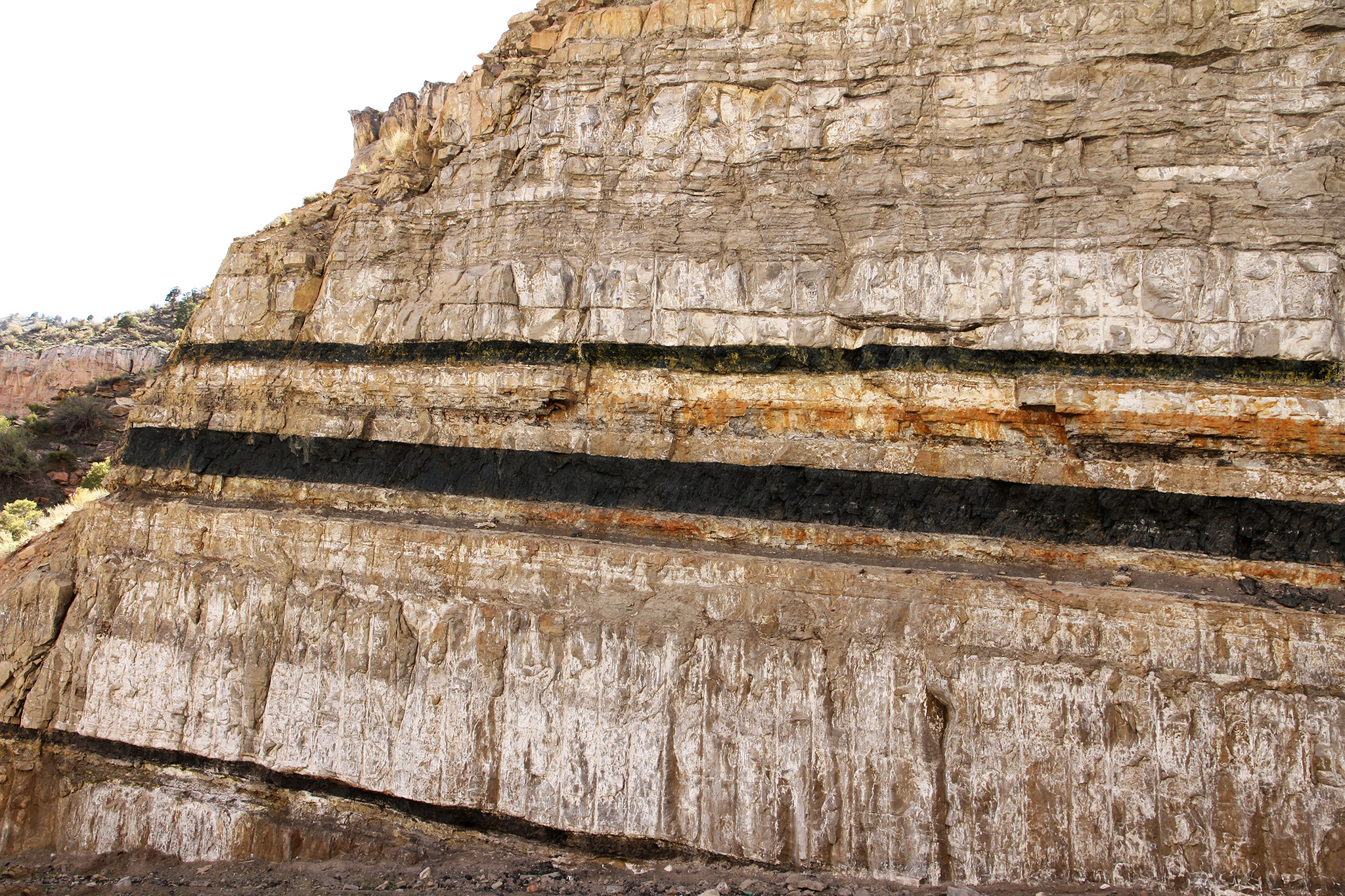 Knife-edge flat gap parallel strata including coal seams in Carbon, Utah. Royce Bair, Used by permission.