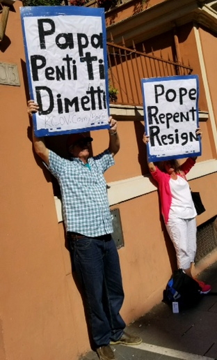 Protesting Pope Francis at the Vatican, DBC members Ken & Jo Scott, 2018